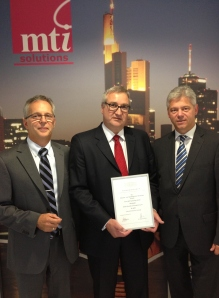 Reiner Lutz, Martin Traeger and Rainer Held collect their certificate