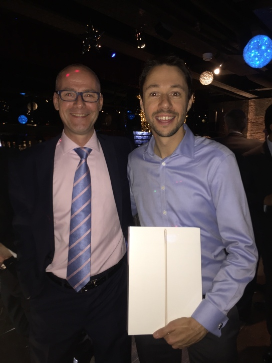 Ian Parslow presents Andrew Ellard with his Ipad